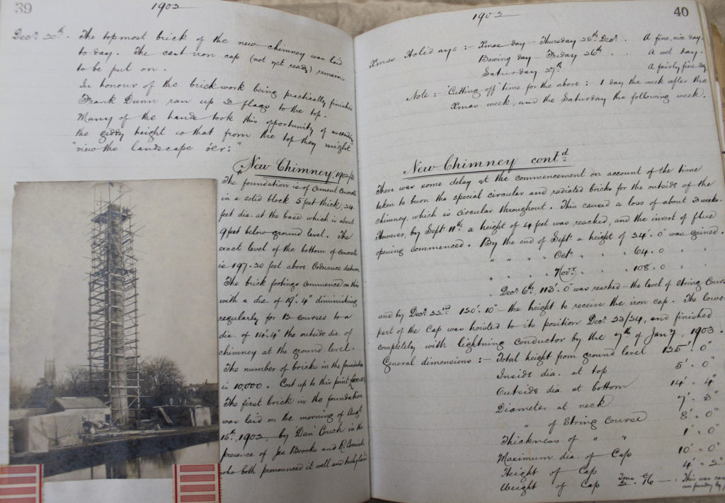 a page of a log book, with photo of new chimney and handwritten text