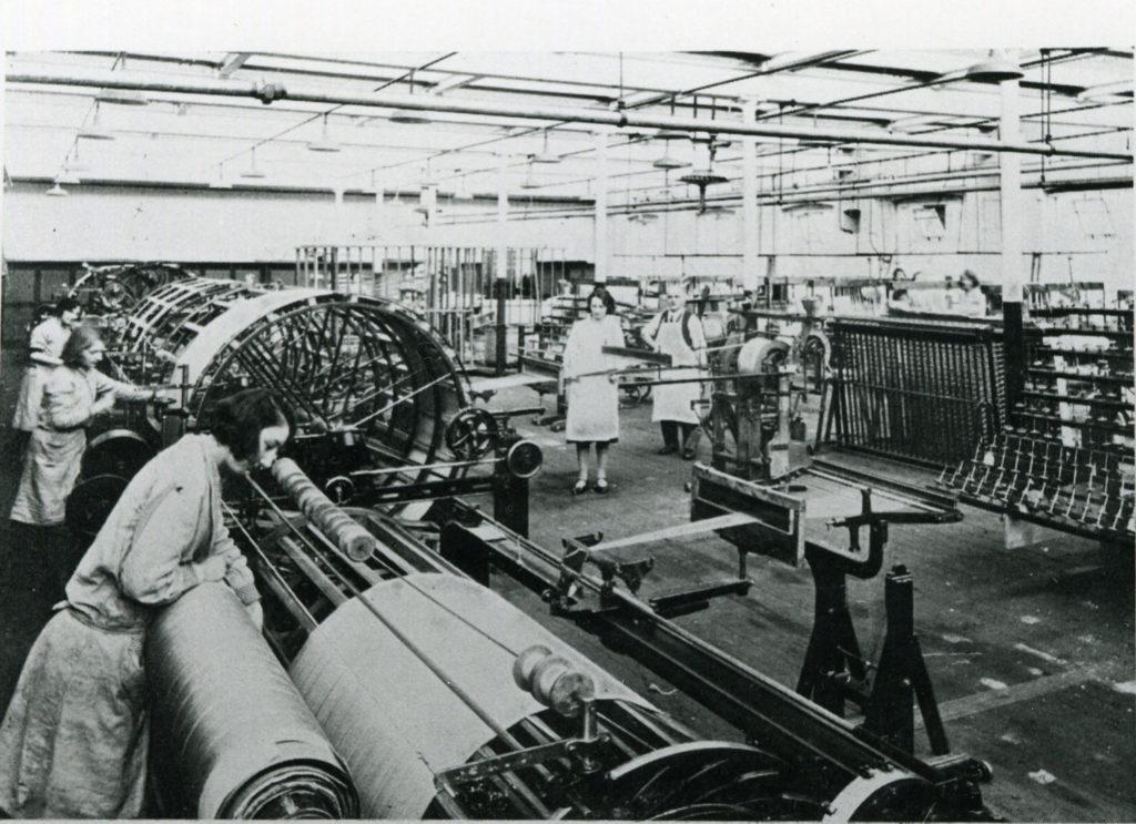 women working on the factory warping department