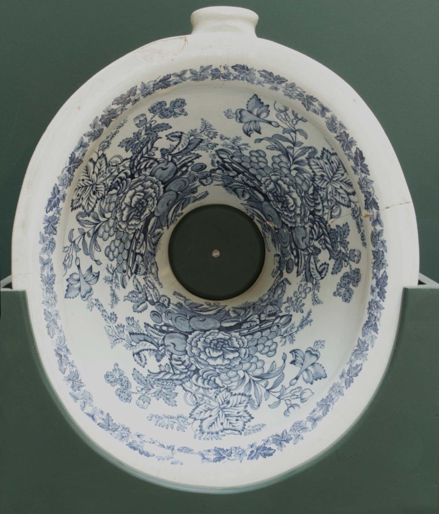 a photo of a decorated toilet bowl