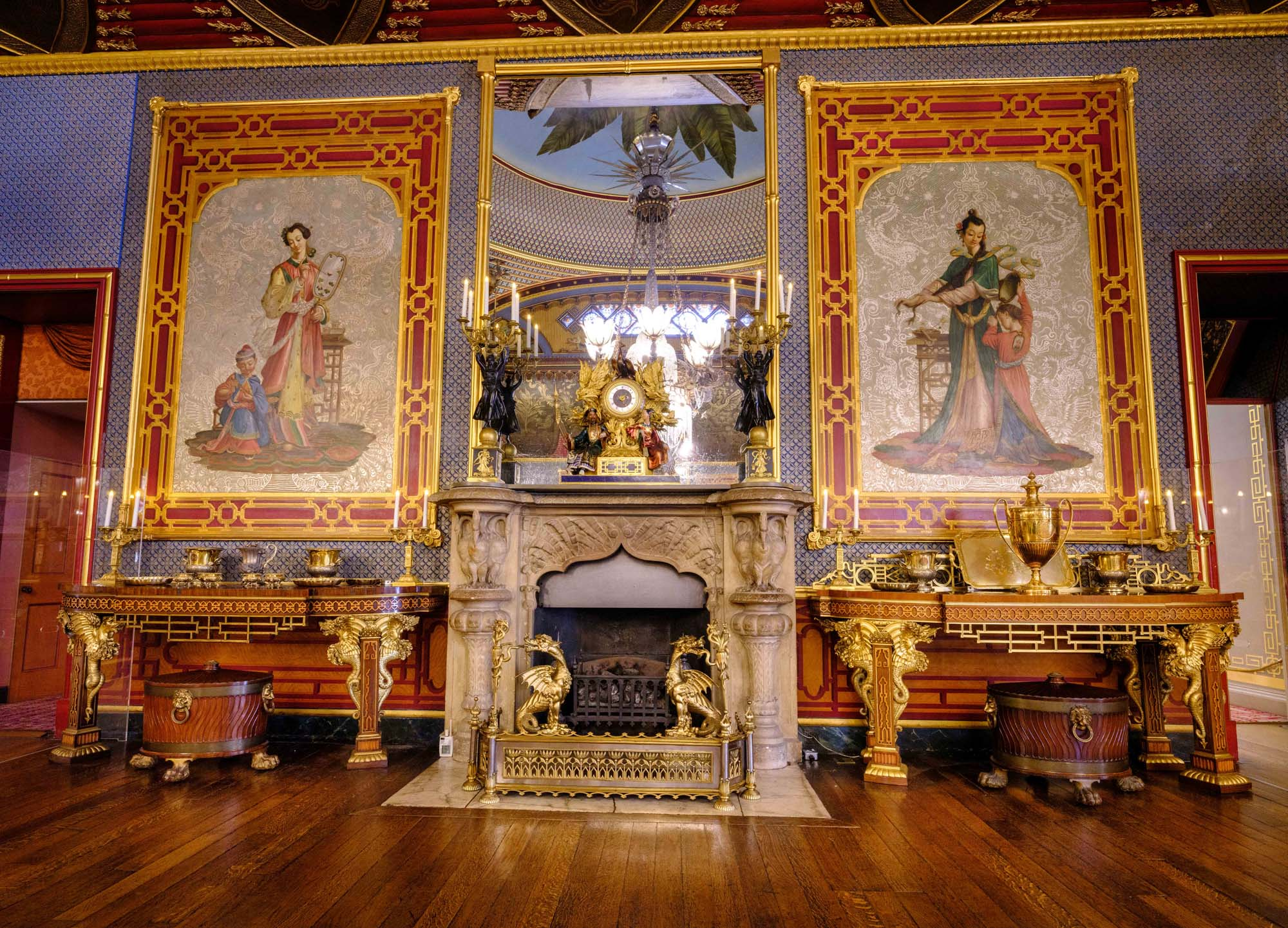 a photo of an ornate chinoiseried room with golden mantelpiece featuring an ornamental clock