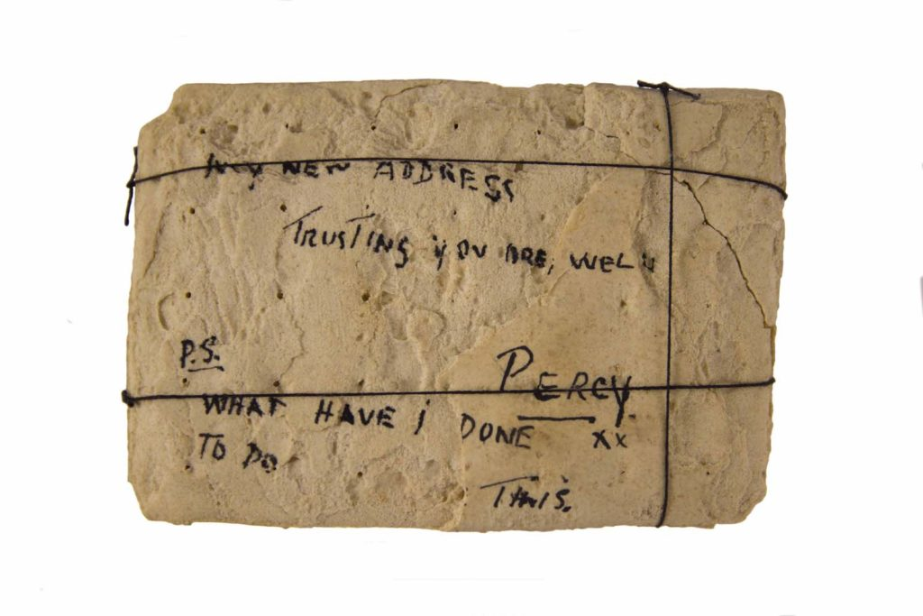 a photo of a hard biscuit with handwriting on it in the manner of a postcard