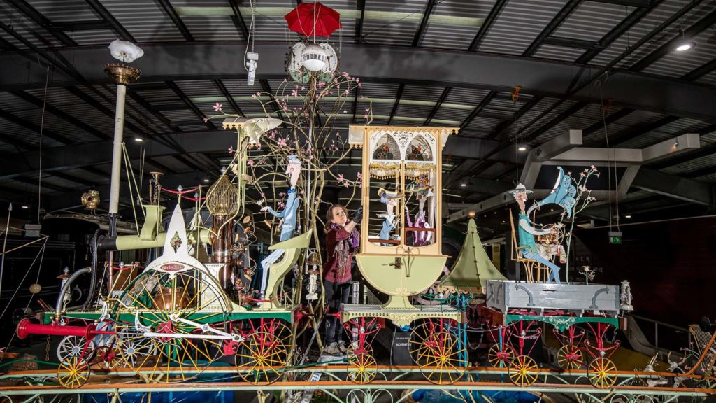 a photo of a large automota sculpture with railway carriages animals and people
