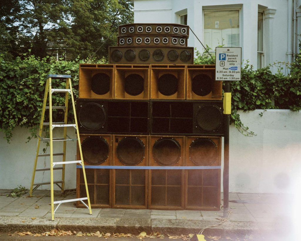 a photo of a series of sound system speakers stacked up on each other