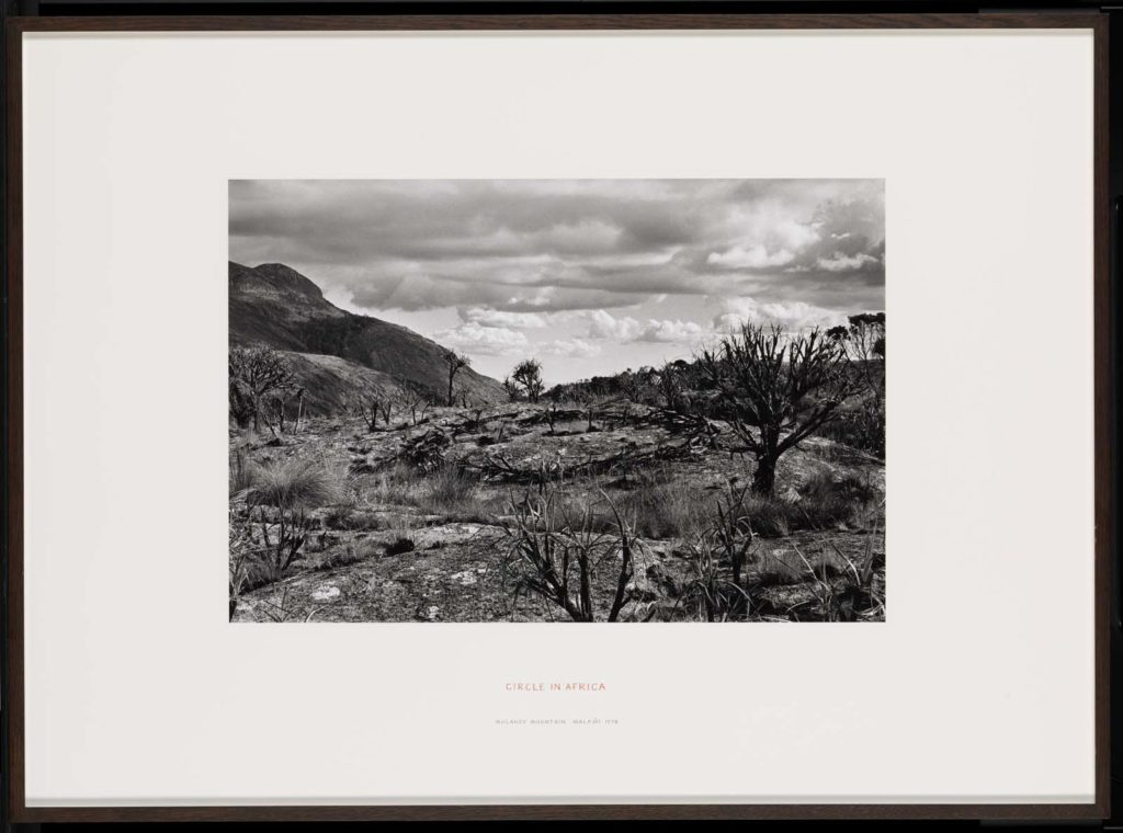 a photo of an arid landscape with circle shape in the foreground