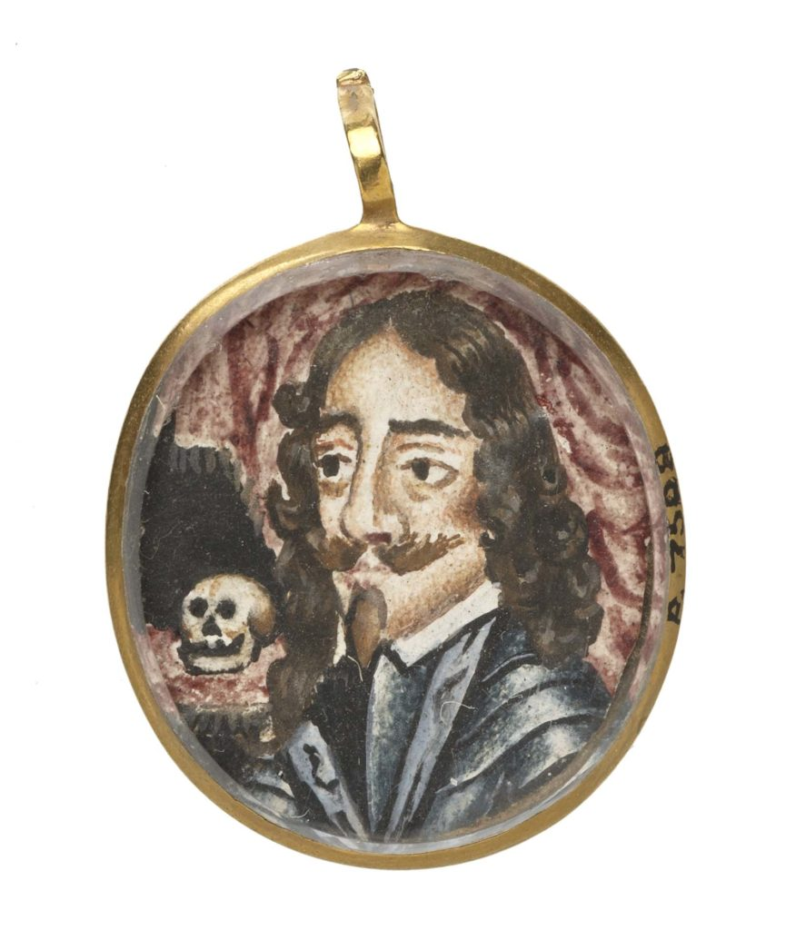 Miniature portrait of Charles I in armour in an oval gold pendant. Three-quarters profile to left, with a skull on a cushion above his right shoulder. The portrait, protected by glass, is executed in black, brown and dark red pigment on a paper or ivory ground.