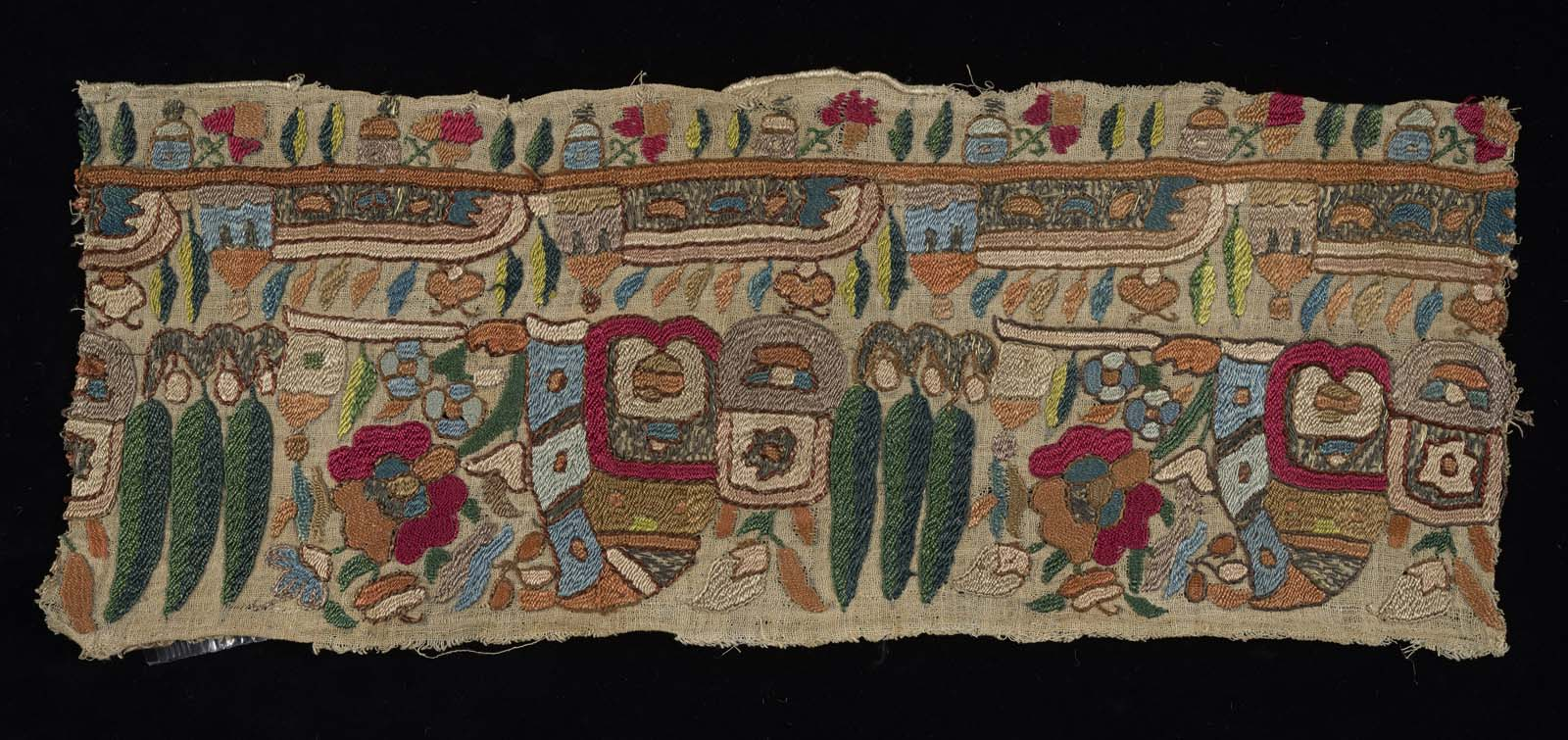 a photo of a piece of colourfully embroidered fabric