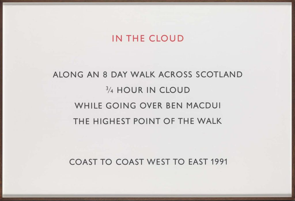 a photo of a framed ppice of text describing walking through clouds in the hills