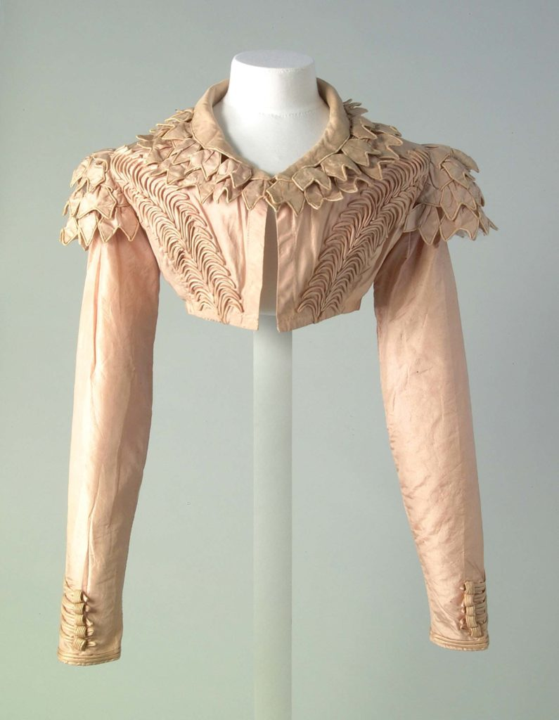 a photo of a pink high waisted cardigan