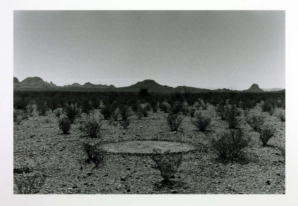 a photo of a circle in a desert-like setting