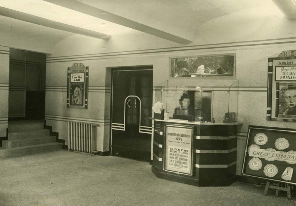 a photo of a cinema foyer with ticket booth