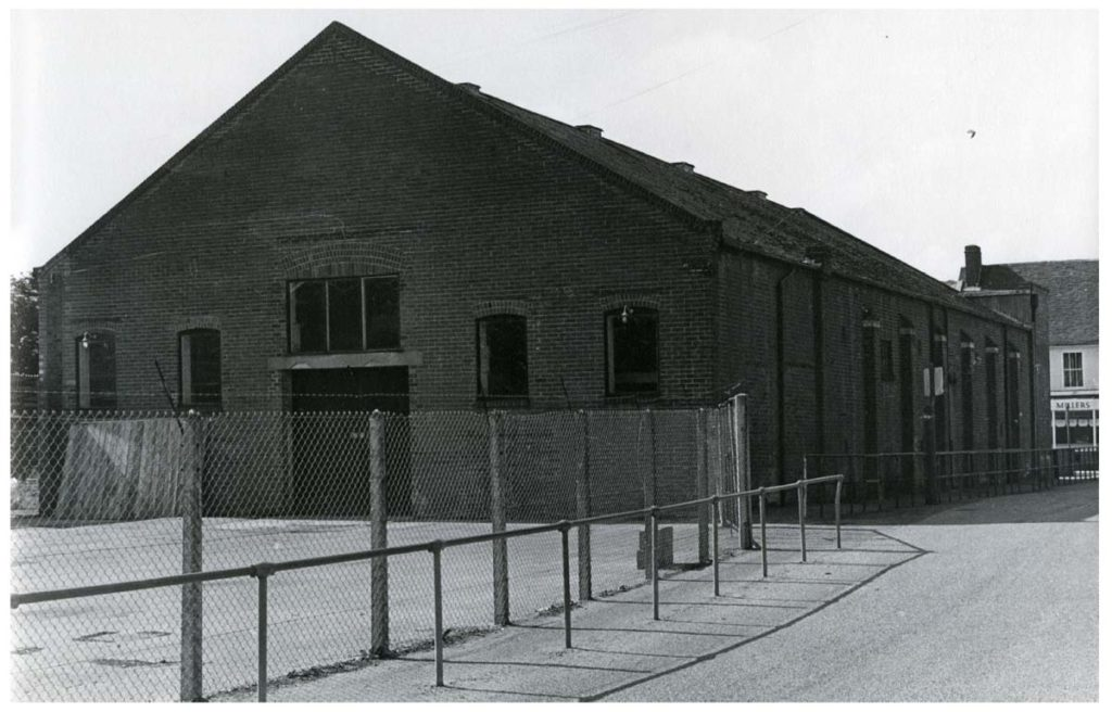 a black and white photo of a large semi derelict building