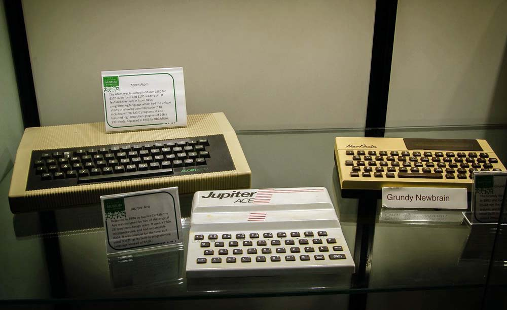 a photo of three basic keyboard computers on a table