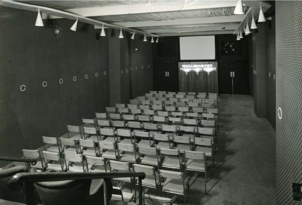 a photo of the interior of a small cinema with seating and screen