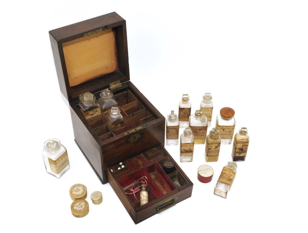 a photo of a medicine chest with glass bottles