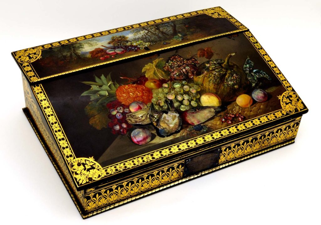 a decorated writing chest with fruit tableaux decoration
