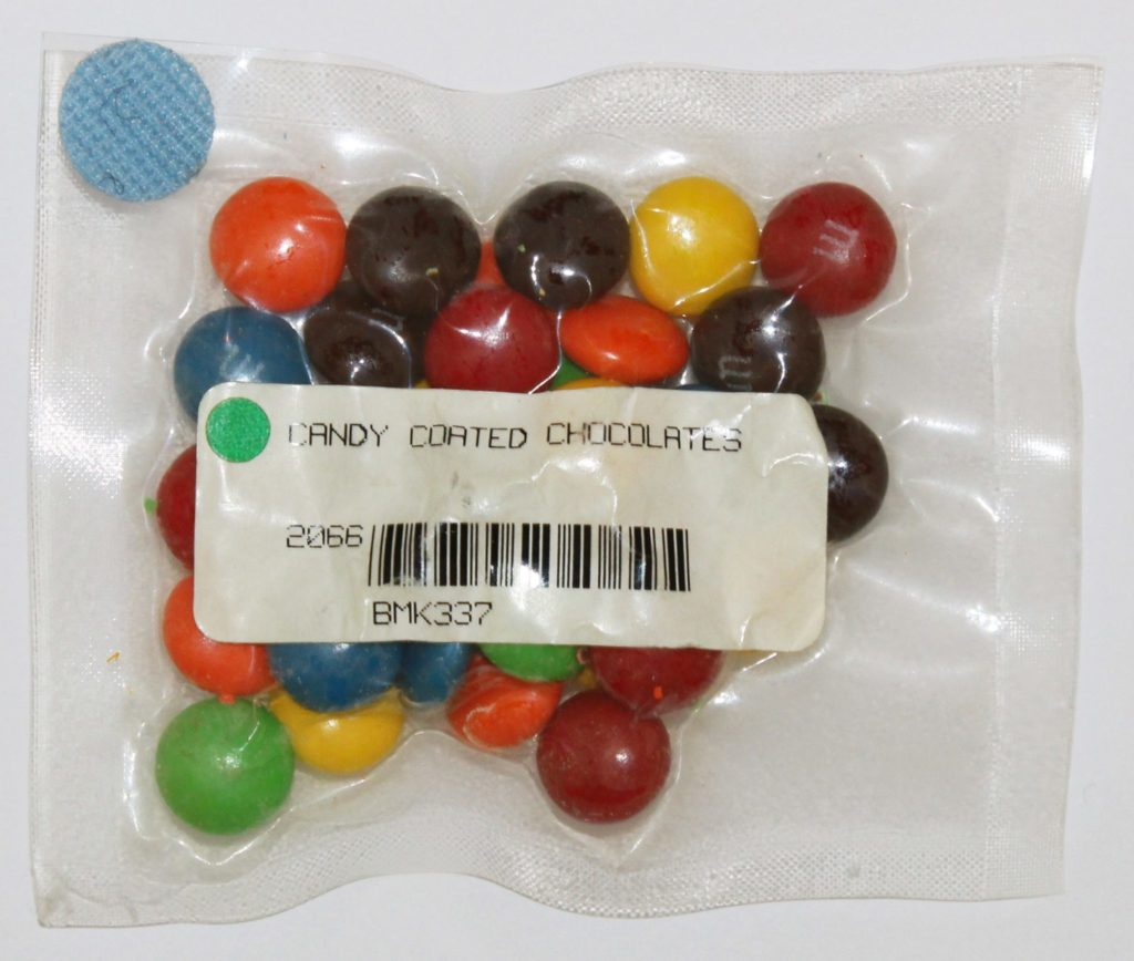 a small see through plastic bag of m and m type chocolates