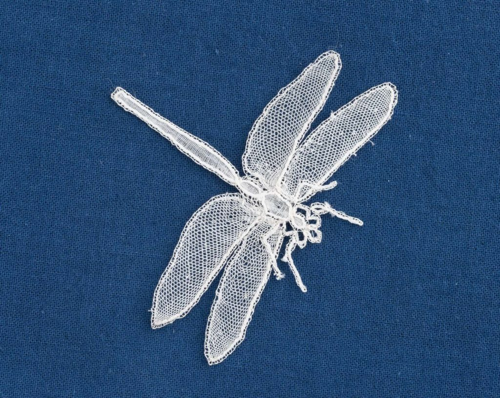 a photo of a dragonfly made from lace
