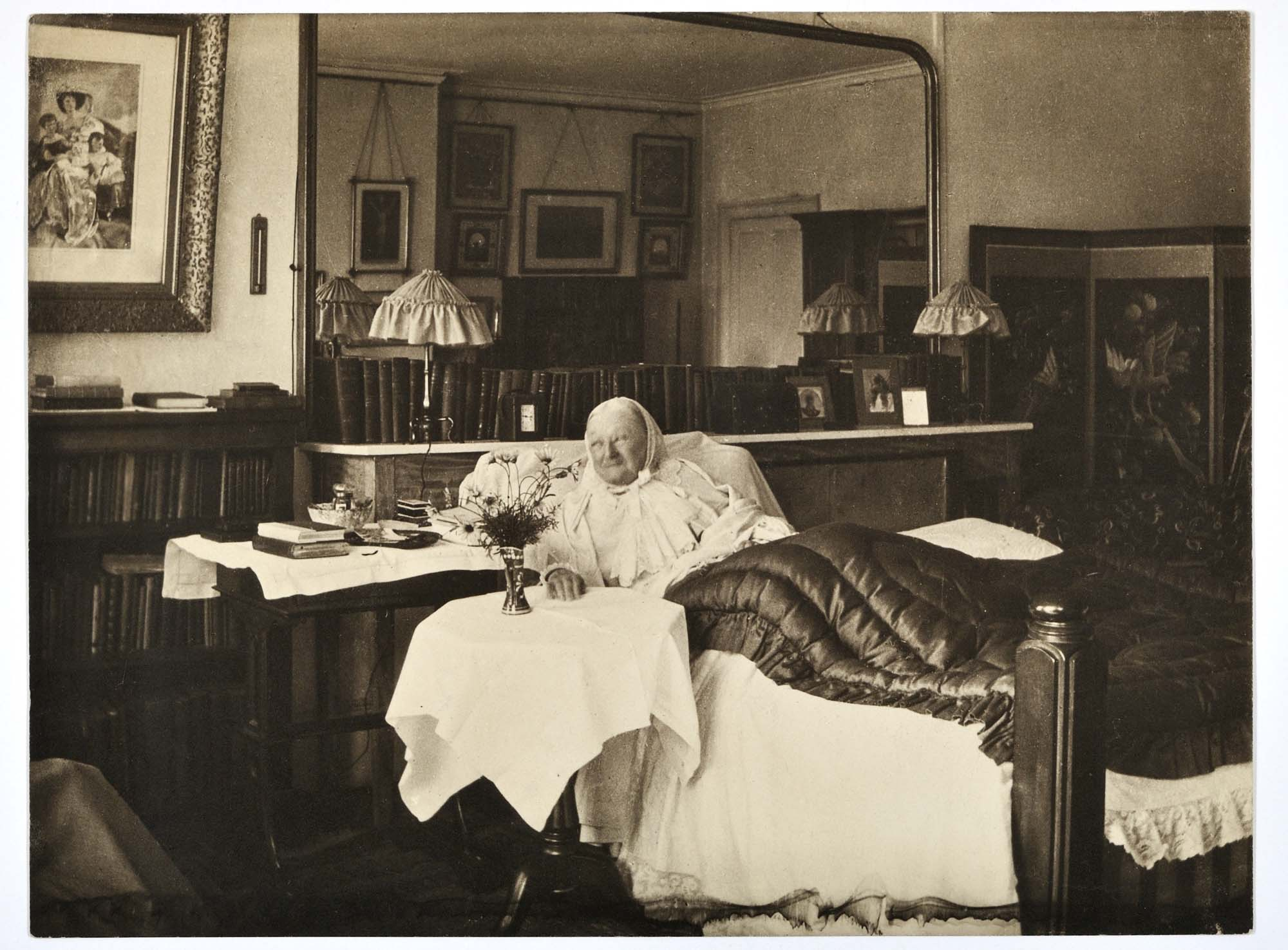 a photo of an elderly woman in bed