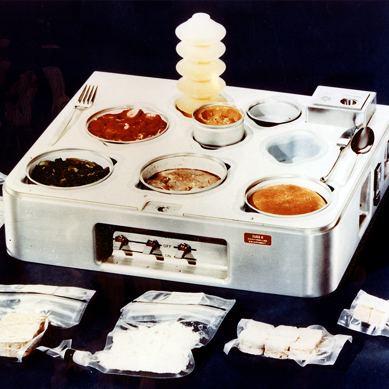 a photo of a small cooker stype device with pockets of food in its surface