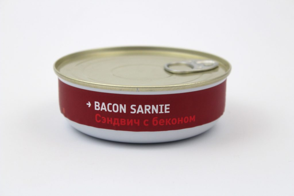 s small round food tin with the words bacon sarnie on the side