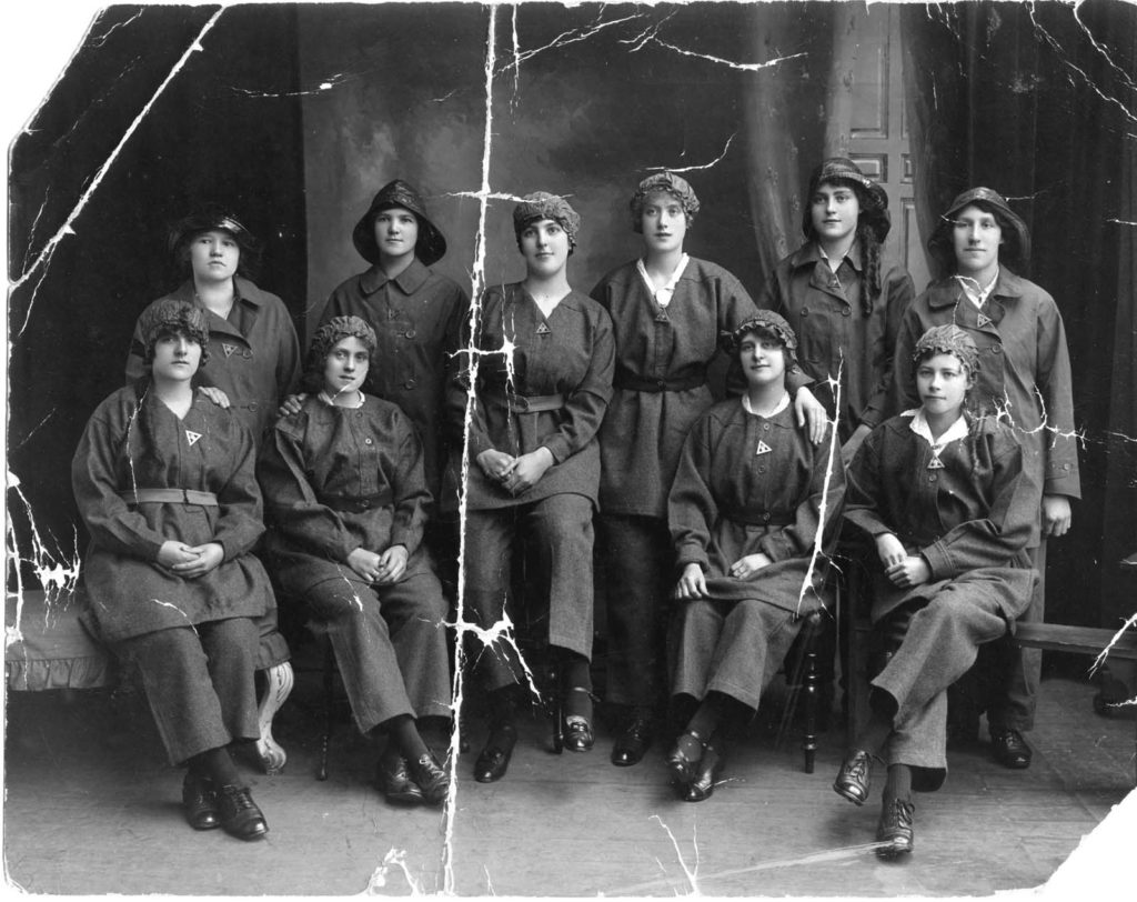 a photo of a group of women in munitions worker dress