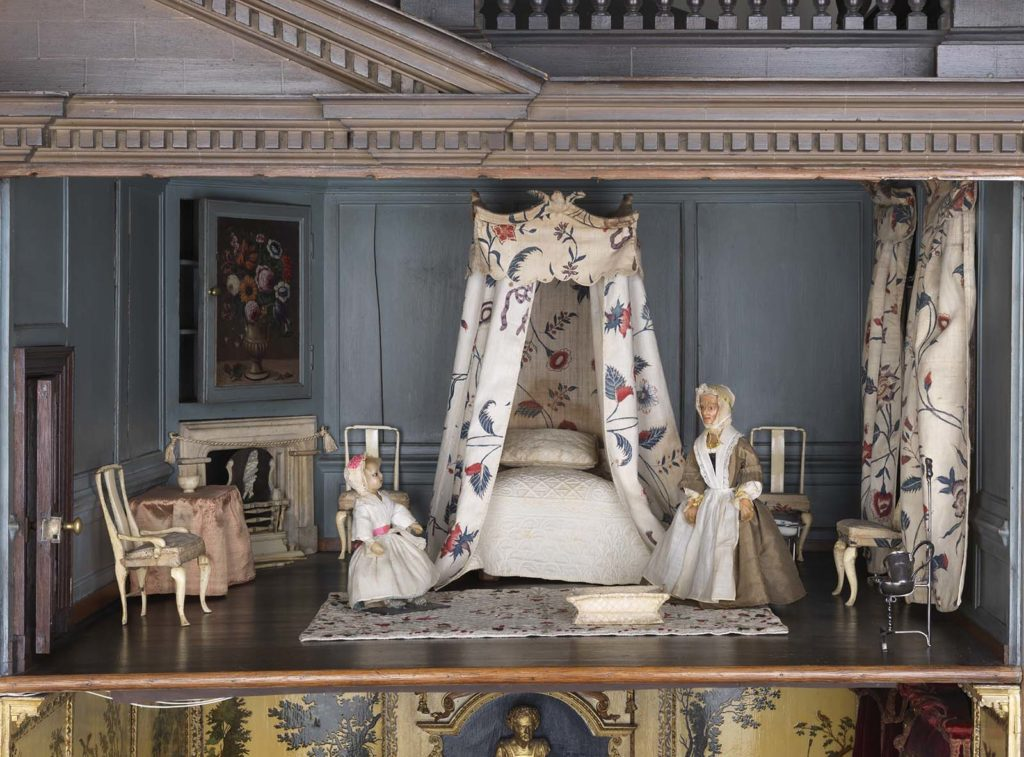 interior view of a dolls house bedroom with four poster bed