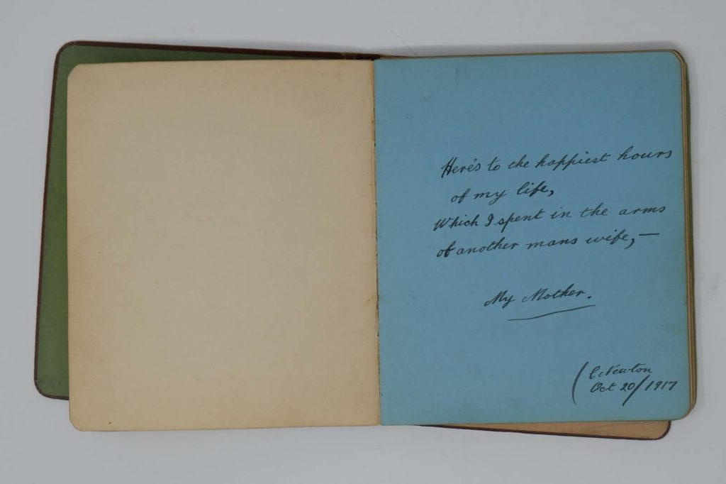 a photo of an open autograph book with a poem about spending time with a mother