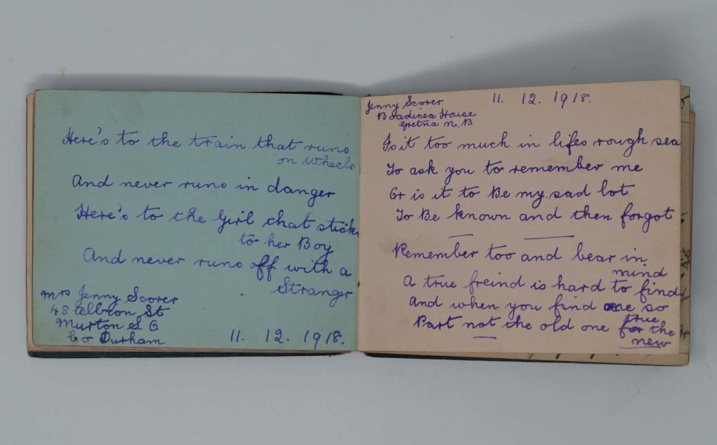 a photo of an autograph book with an epigram about staying faithful