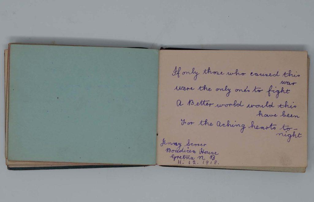 a photo of an open autograph books with hand written epigram