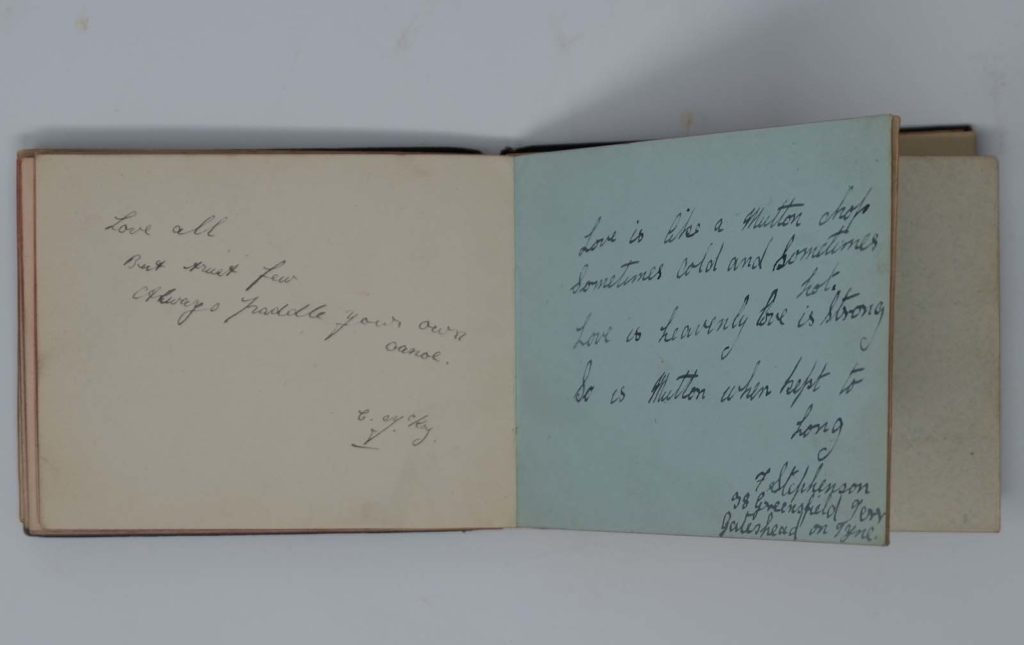 an open autograph book with writing inside