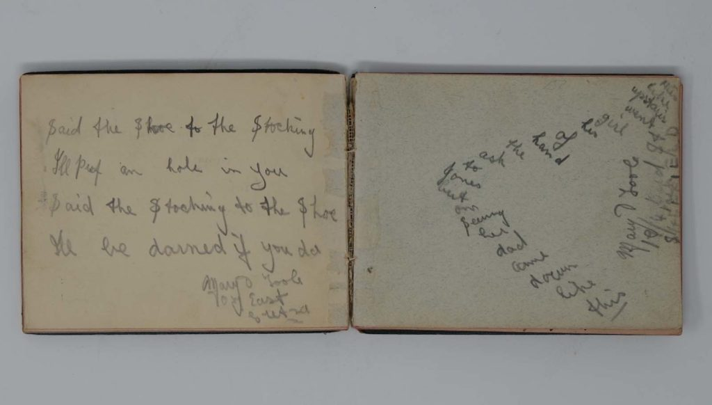 an open autograph book with a little epigram poem about a stocking and a shoe