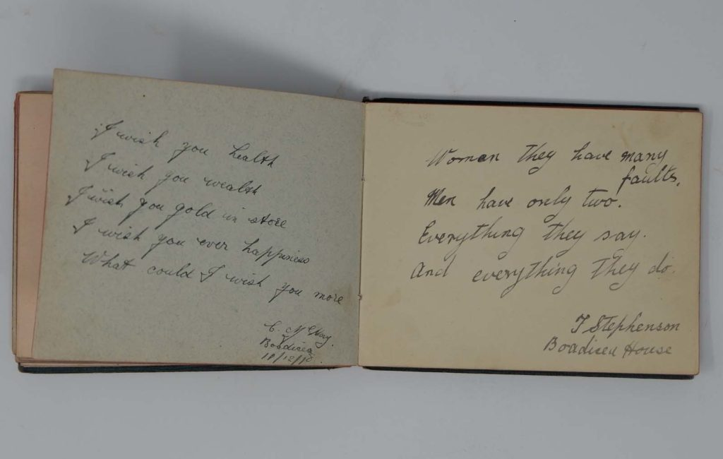 a photo of an open autograph book with two epigrams