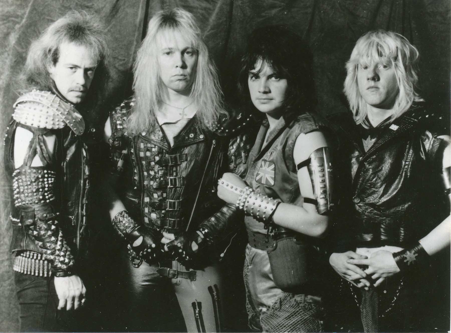 black and white photo of four men in heavy metal leathers