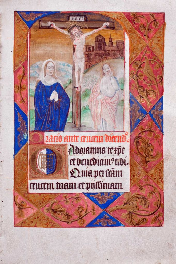an illuminated manuscript page showing Christ on the cross