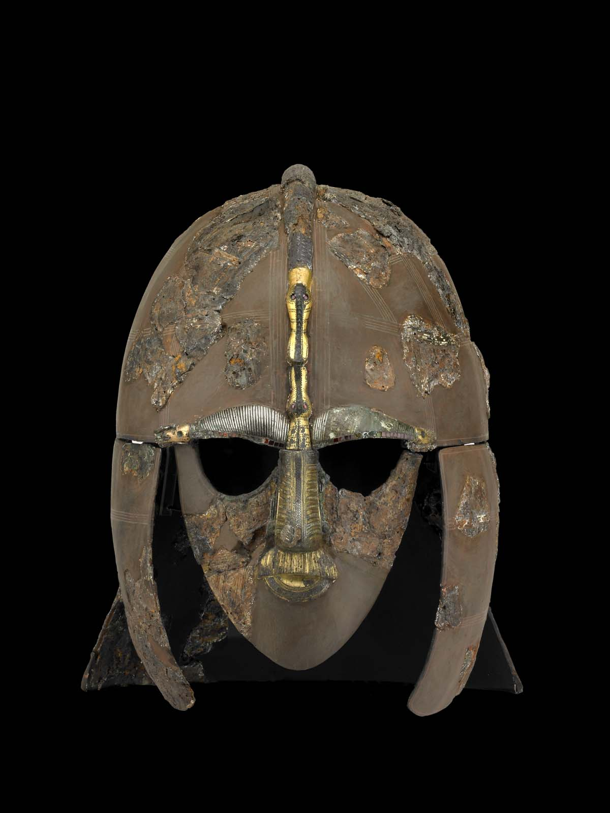 photo of a the sutton hoo helmet a full face helmet with face shield domed top helmet and ear protectors