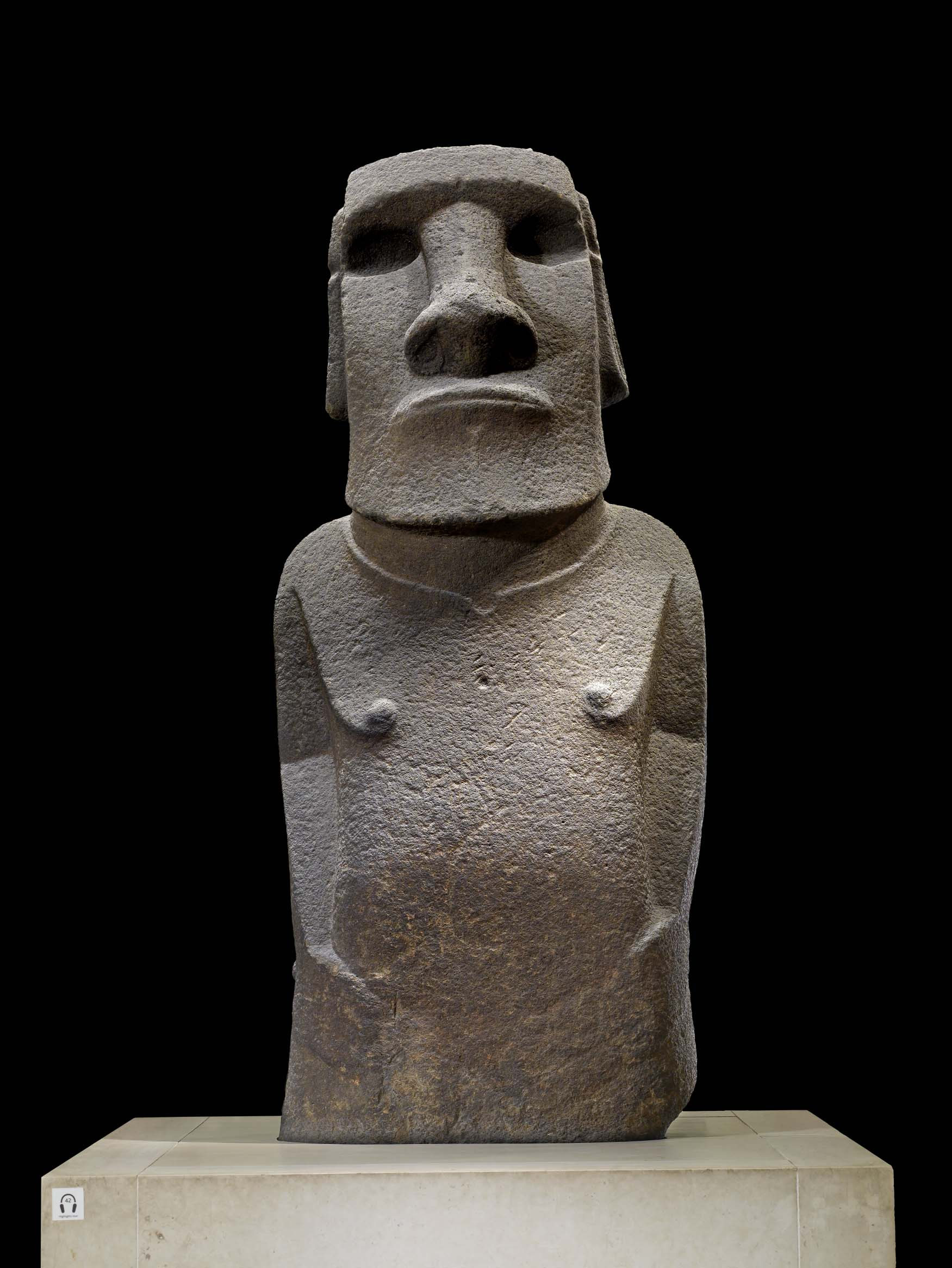 a stone figure with a large square jaw