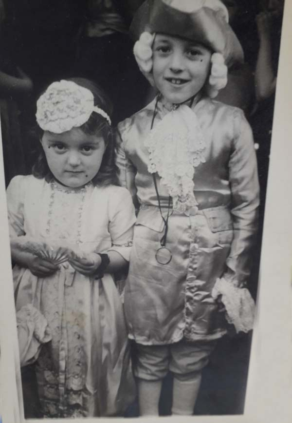 a photo of tow young children in fancy dress