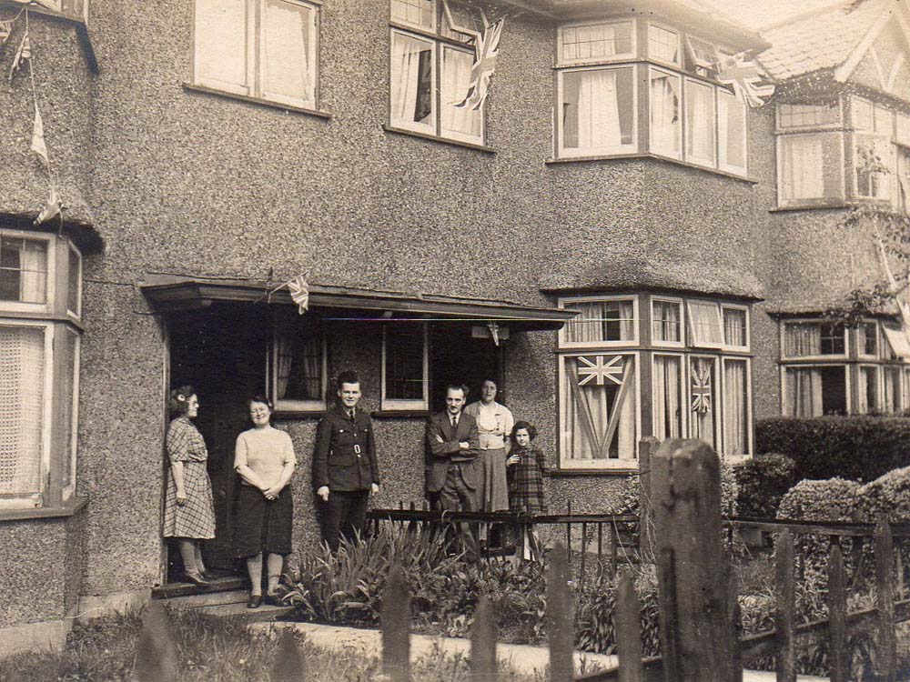 a photo of people standing outside their semi-detached houses