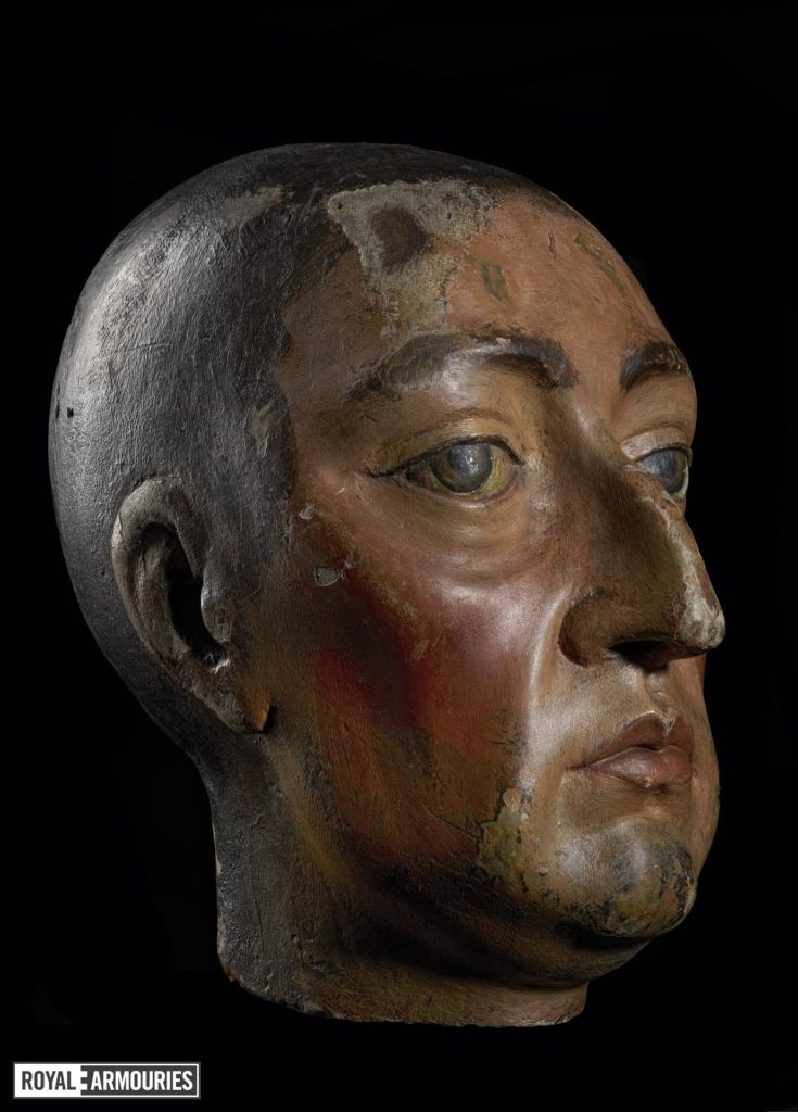 a carved wooden head depicting William III