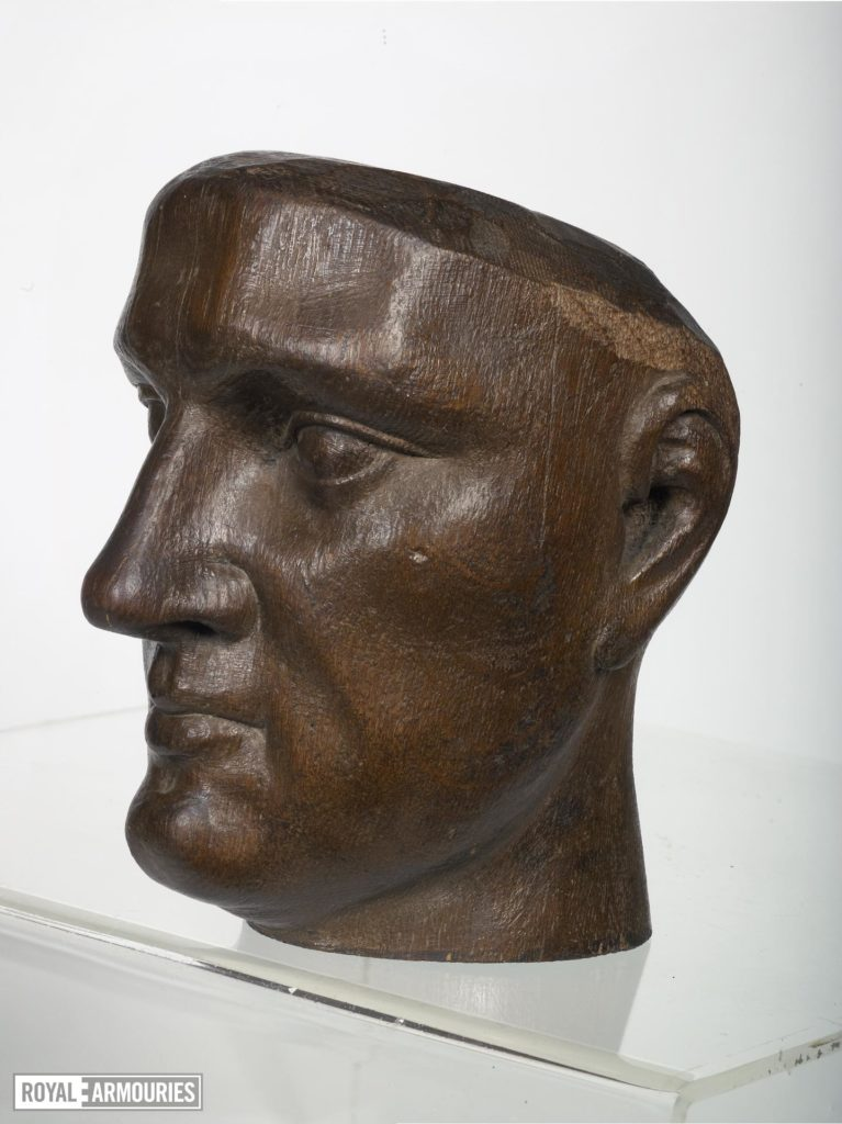 a head carved from wood