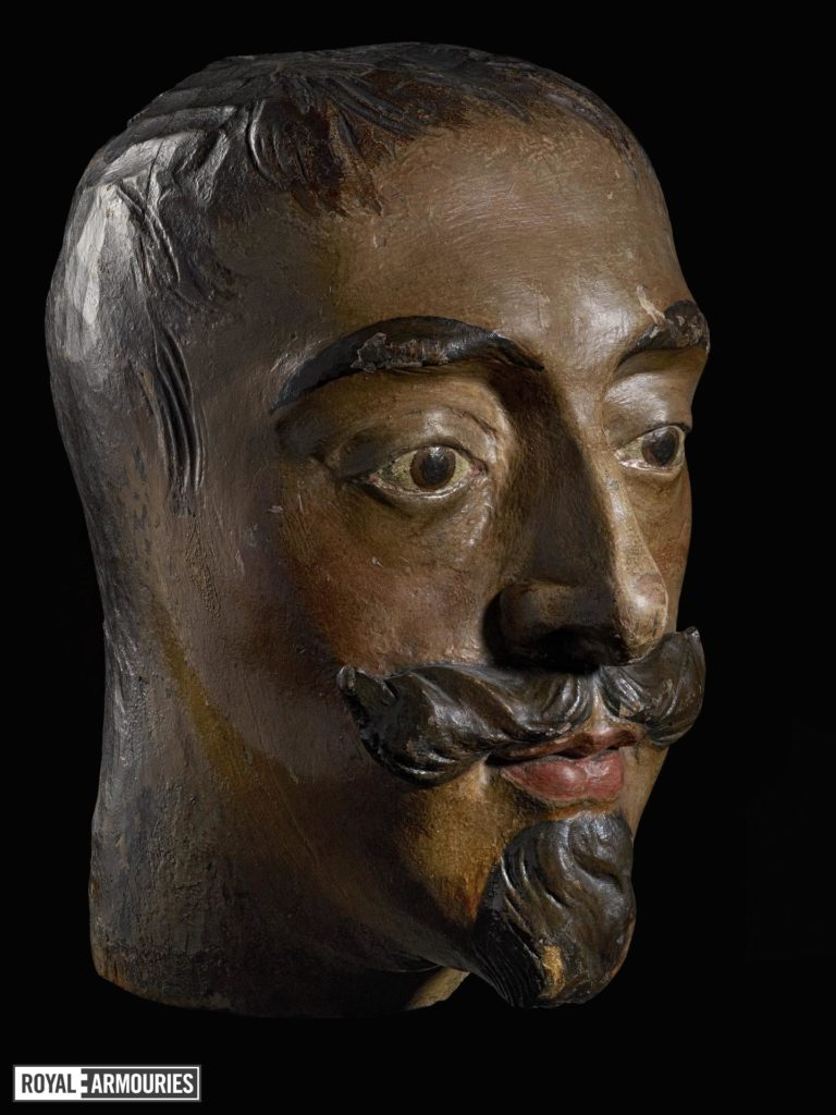 a carved wooden head depicting Charles I