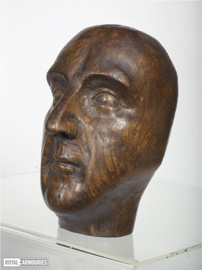 a carved wooden head depicting Henry VI or VII