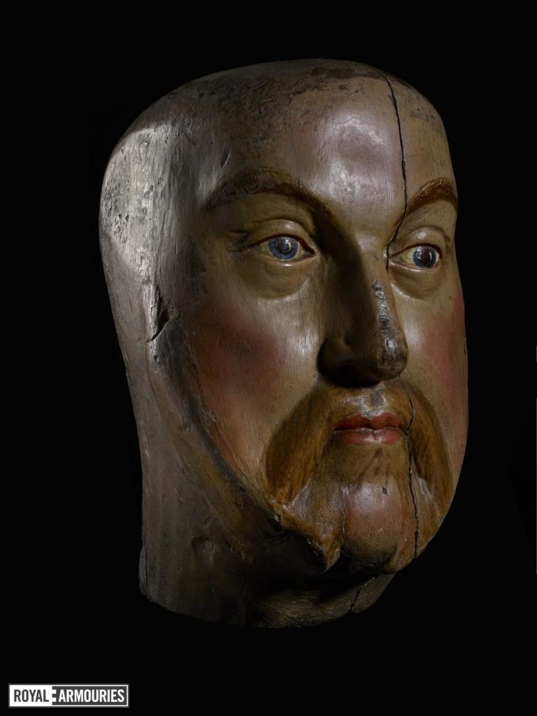 a carved wooden head depicting Henry VIII