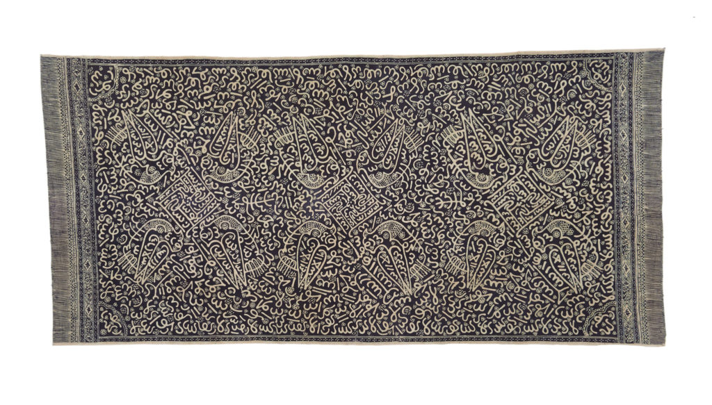 a piece of black fabric with white batik design