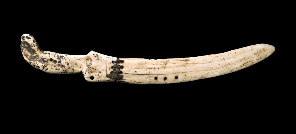 a knife made from walrus ivory