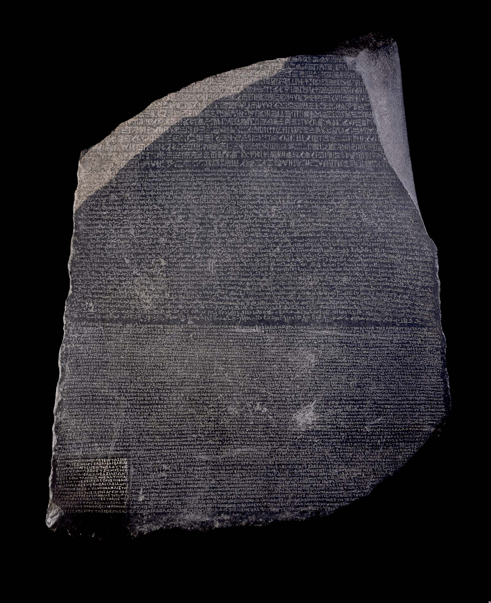a photo of a stone carved in different heiroglyphs