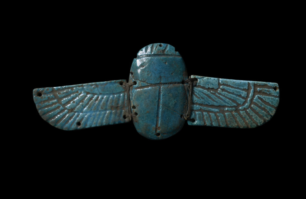 a faience scarab with wings
