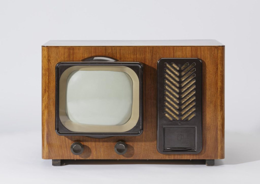 wooden television set with small screen and decorative herringbone speaker