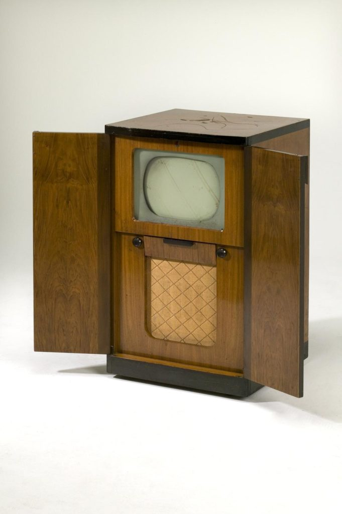 1950s tv in large wooden cabinet with doors open