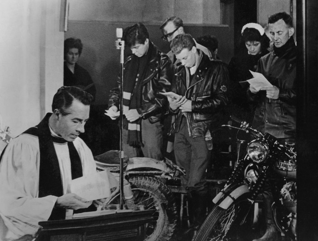 a photo of a motorcycle club with a vicar